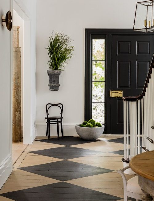 Historic Home Entryway with Checkerboard Floor