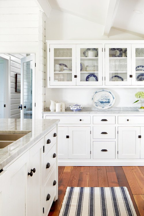 White cottage style kitchen with glass front cabinets