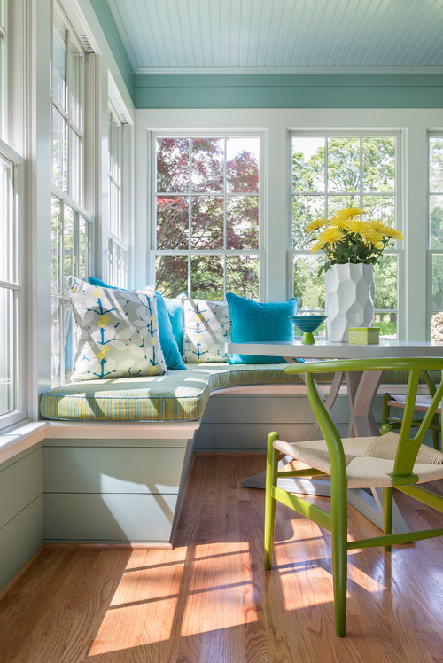 Cottage style sun room in bright green and blue