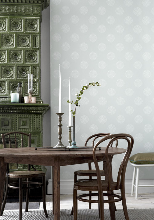 Scandinavian Dining Room with Green Fireplace