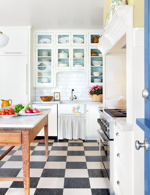 Farmhouse Kitchen with Checkerboard Floor and Glass Front Cabinets
