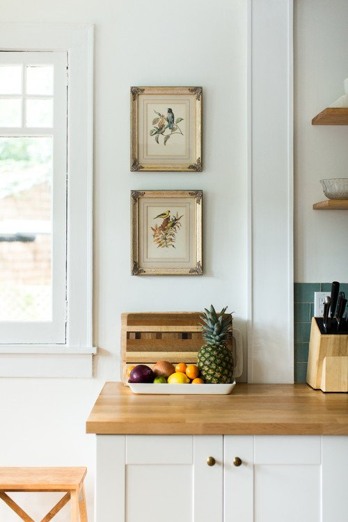 Bird Prints and Bowl of Fruit in Kitchen