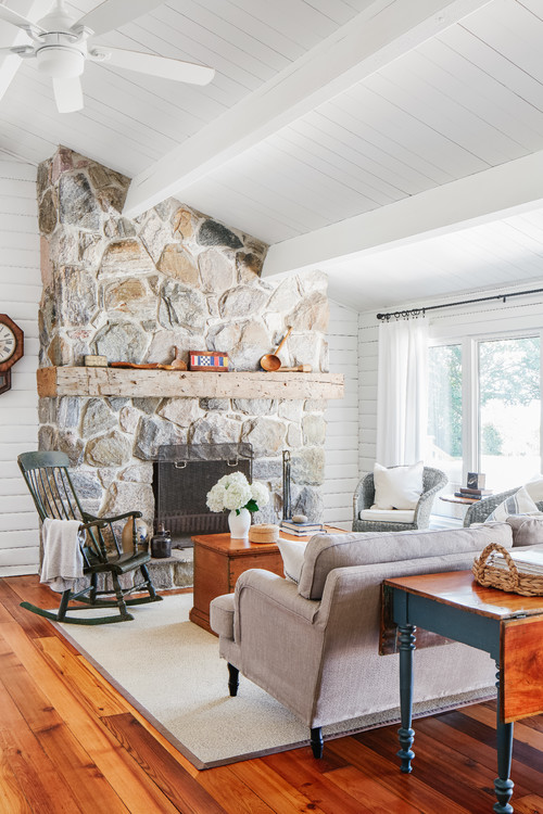 Beach cottage with wood floors and rustic stone fireplace