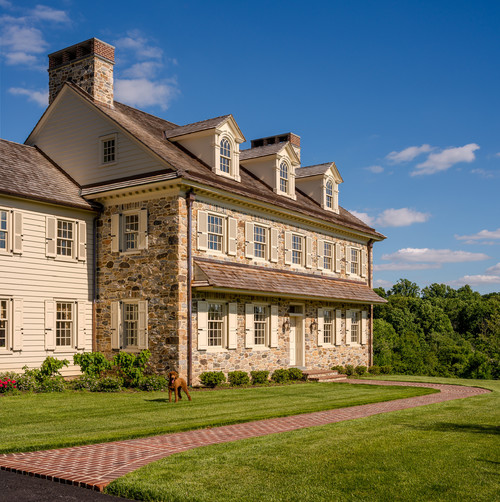Stone and clapboard Colonial farmhouse