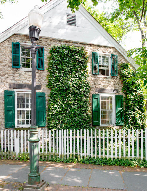 Gorgeous Old Stone House with Turquoise Shutters and White Picket Fence