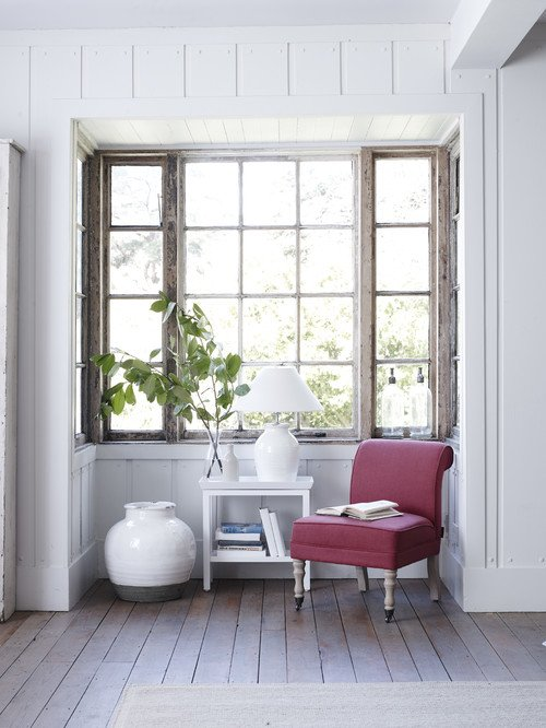 Rustic wood mullioned window in bump-out nook