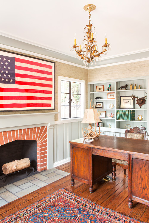 Home Office with Framed American Flag over Fireplace