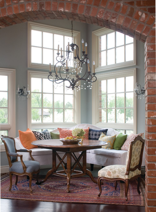 Two-story Mullioned windows in a charming breakfast nook