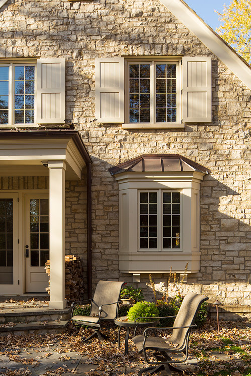 Stone House with Tan Shutters and Trim