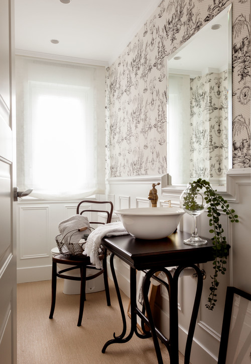 Black and white toile wallpaper in bathroom