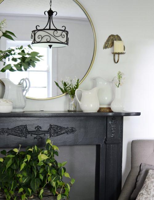 Round Brass Mirror above Vintage Mantel