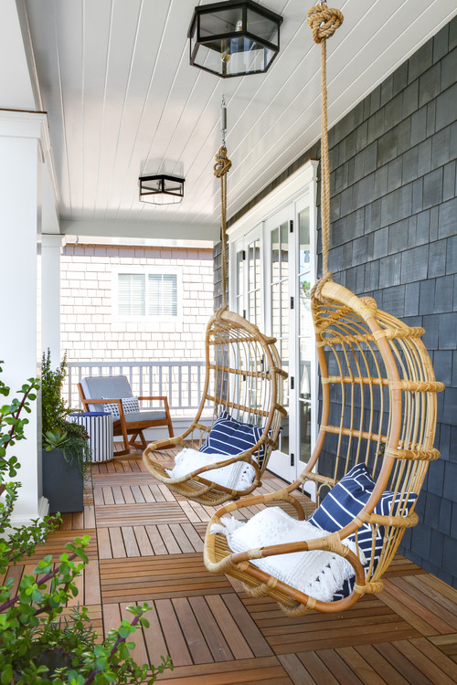 Pair of Rattan Chair Swings on Porch