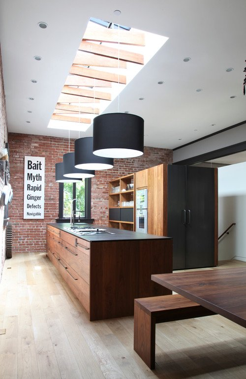 Industrial Style Kitchen with Skylights and Pendant Lighting