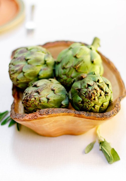 Artichokes in a Natural Wood Bowl
