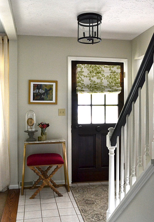 Lake Cottage Entryway with Black Front Door