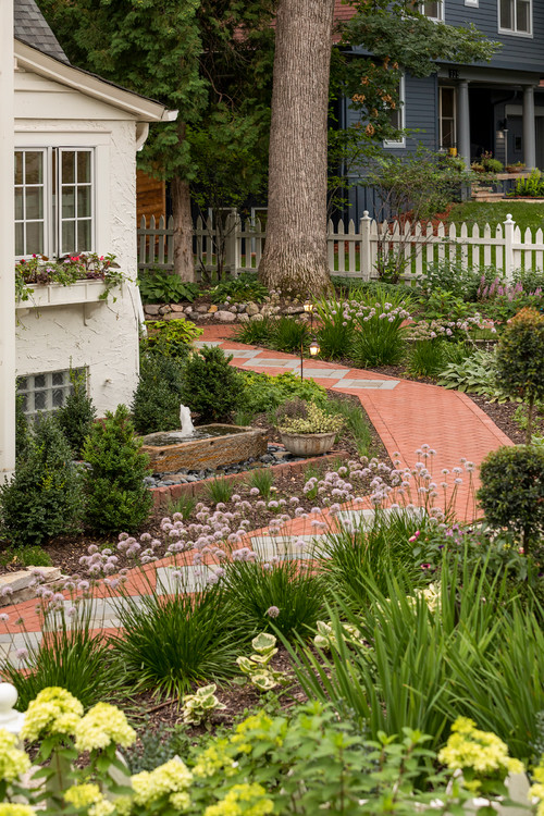 Cottage Garden with Brick Walkway and Stone Fountain
