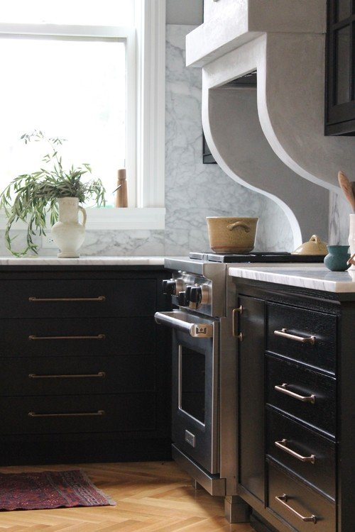 Curved range hood in country kitchen