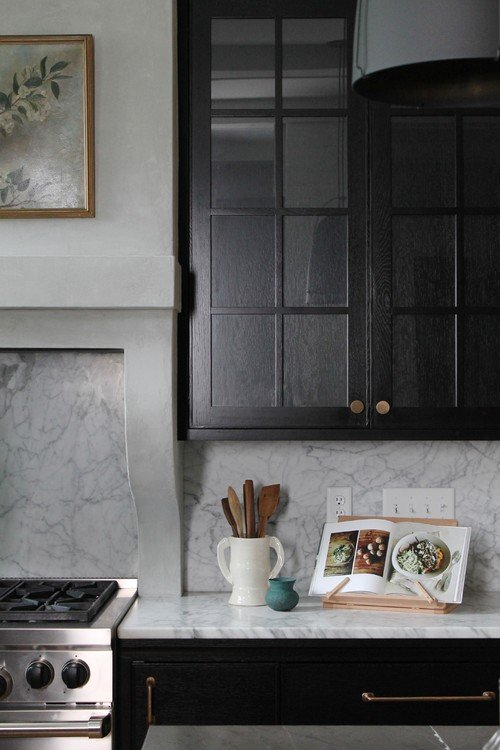 Black kitchen cabinets with gold hardware
