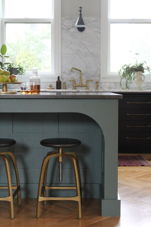 Blue-Gray Kitchen Island Paired with Black Cabinets and Gold Hardware