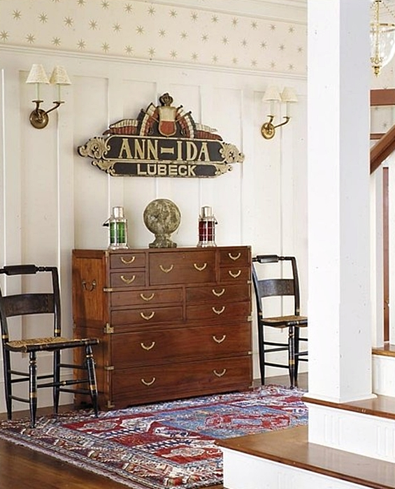 Antique Furniture Display at Bottom of Staircase