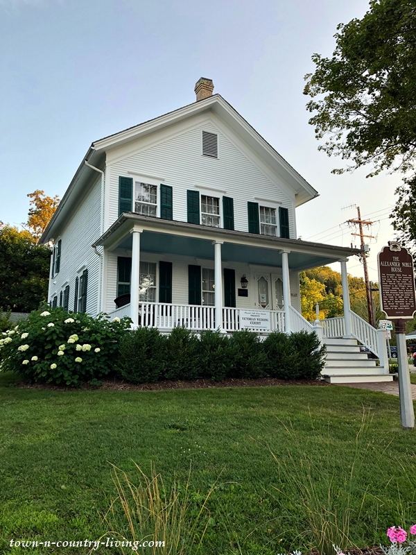 White Clapboard Farmhouse with Front Porch