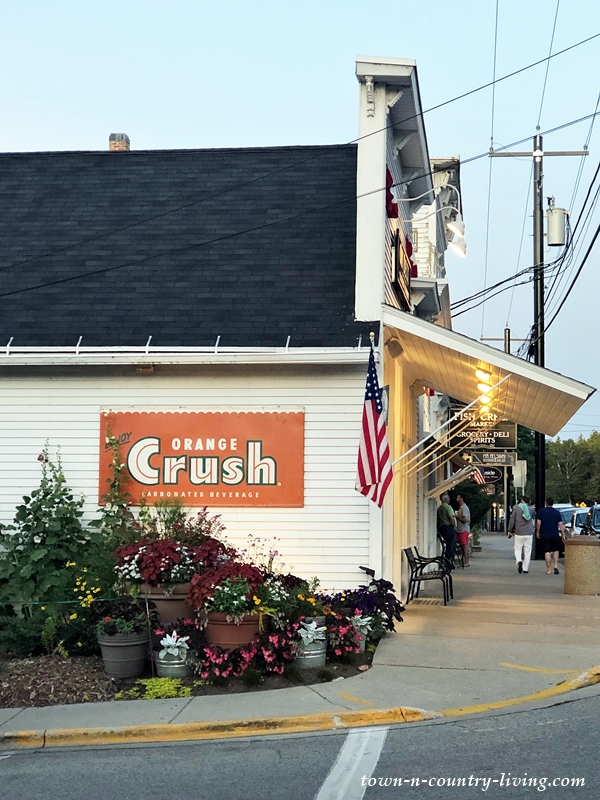 Old Time Store in Door County with Orange Crush Sign