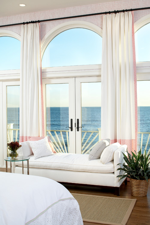 Waterfront home bedroom with view of the ocean