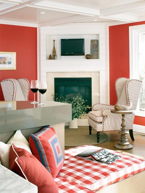 Coral Walls and White Trim in Cozy Seating Area with Fireplace and Wing Chairs