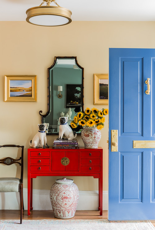 Entryway with blue door and red table