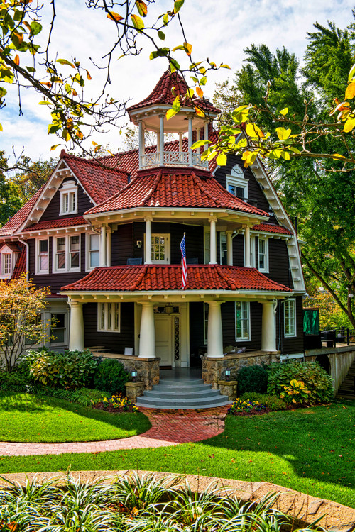 Beautiful Brown Victorian with Red Roof