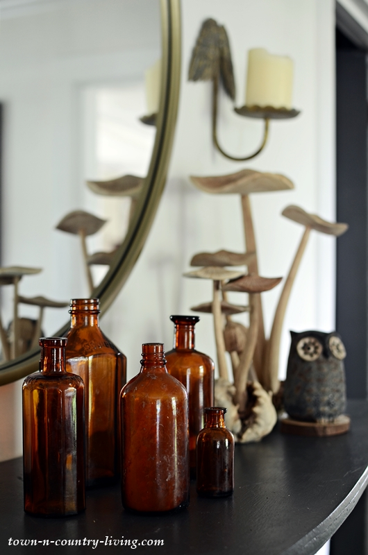 Fall Mantel with Brown Bottles and Wooden Mushrooms