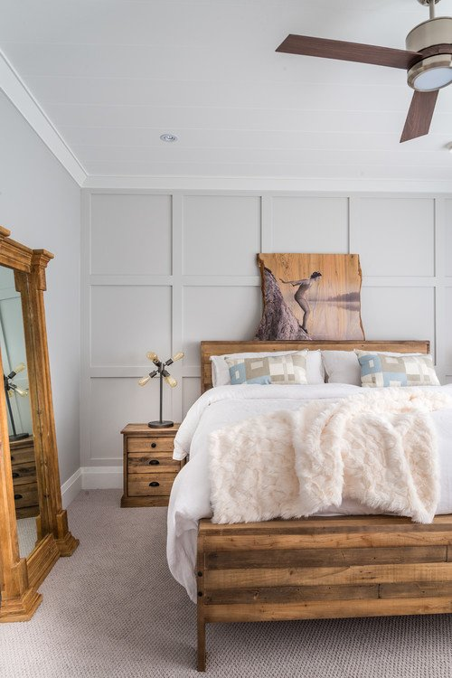 Beach Style Bedroom with Natural Wood Bed and Floor Mirror