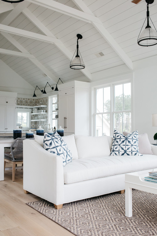 White Couch with Blue Pillows in Open Concept Floor Plan