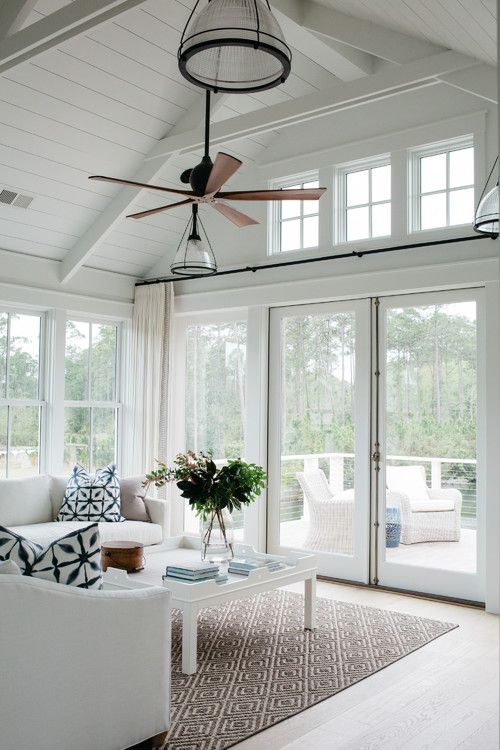 Expansive Windows in White Family Room with Blue Accents
