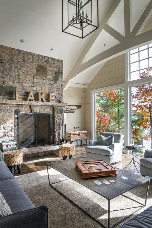 Rustic Living Room with Large Windows and Stone Fireplace