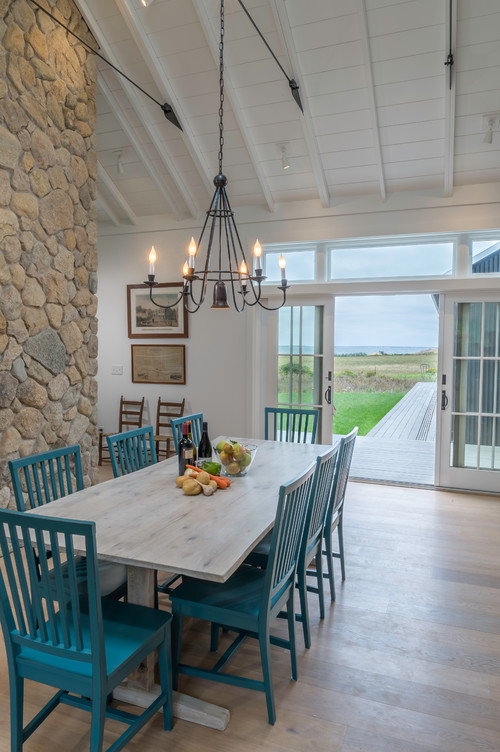 Farmhouse Dining Room with Blue Chairs