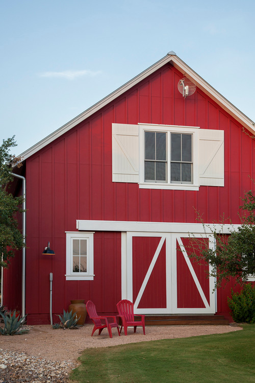 Red and White Barn with Gravel Patio