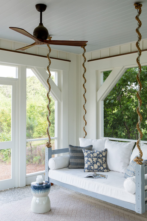 Beach Style Porch with Swing