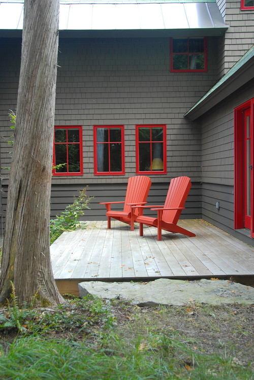 Rustic Deck with Red Adirondack Chairs