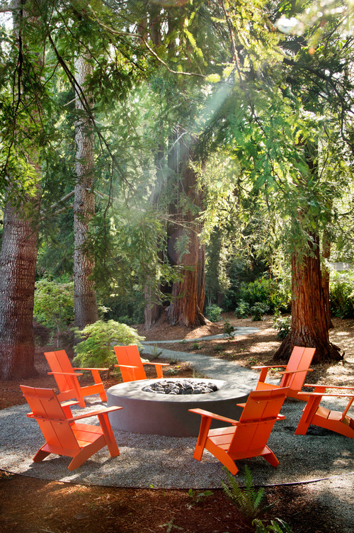Orange Adirondack Chairs Around Fire Pit