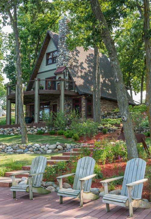 A-Frame House with Adirondack Chairs in Front Yard