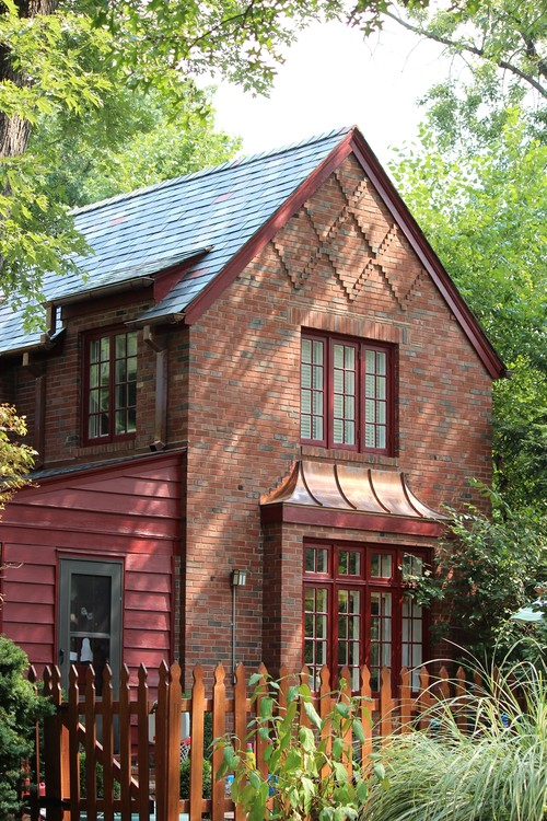 Charming historic brick home with red clapboard siding