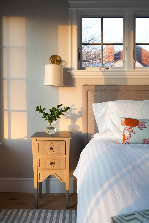Cottage Style Bedroom with Sconce Lighting