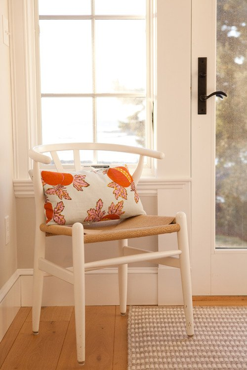Boho Chic Bedroom Chair with Orange Floral Pillow