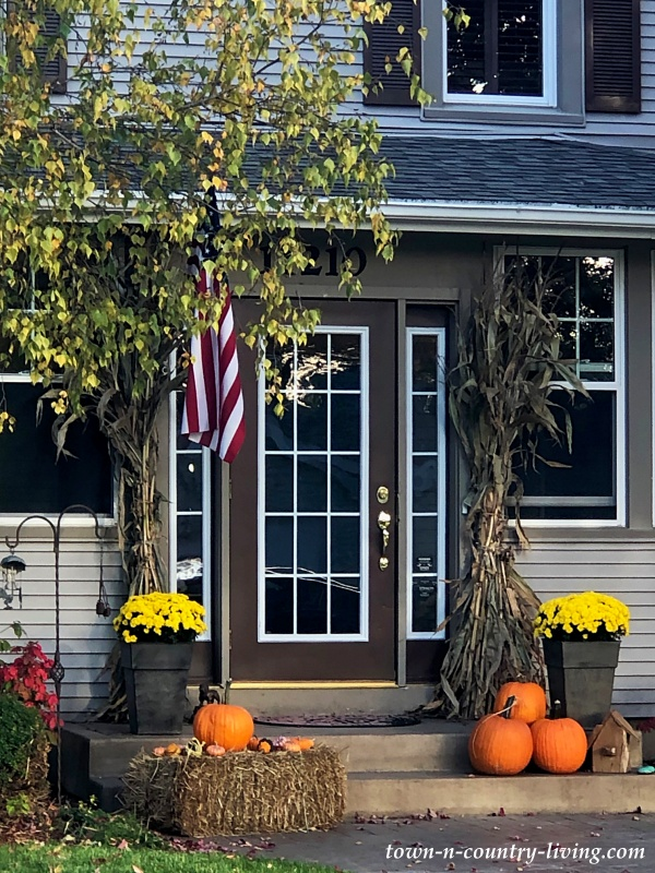 Fall Porch with Pumpkins and Mums