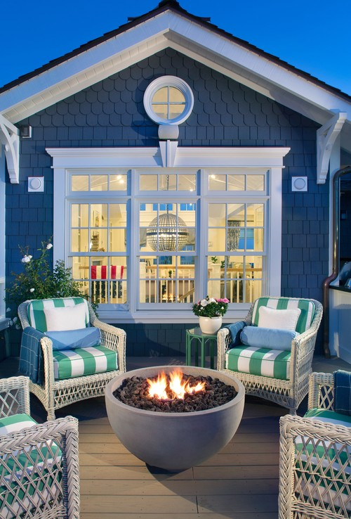 Cozy Patio with Wicker Furniture and Fire Bowl