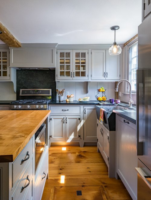 Farmhouse Kitchen with Painted Cabinets and Wide Plank Wood Floor