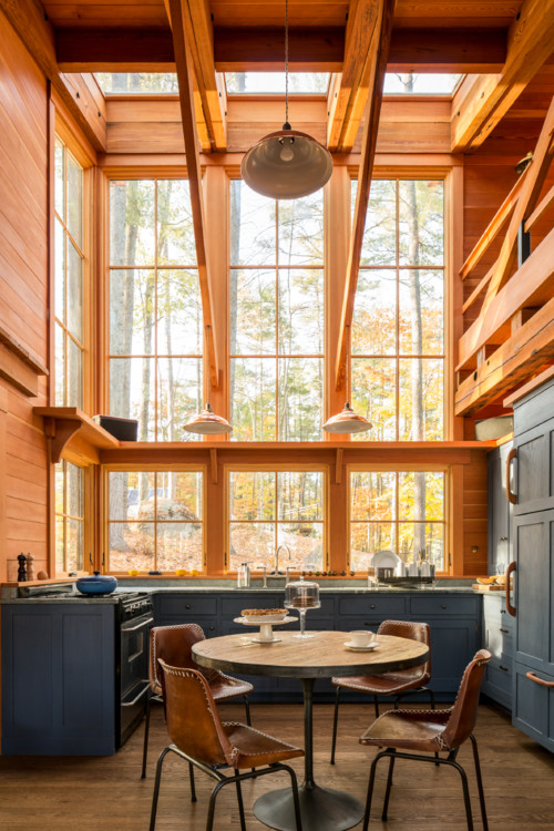 Rustic Kitchen with Expansive Window and Wood Trim