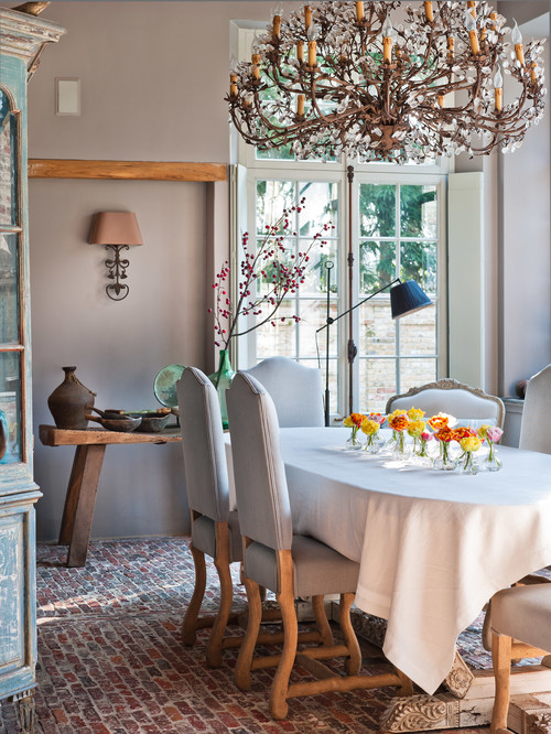 French Country Dining Room with Brick Flooring