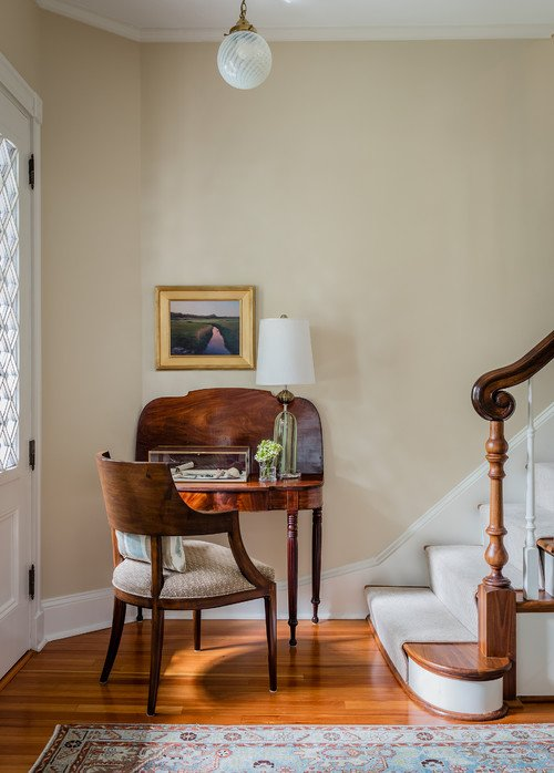 Traditional Entryway with Staircase and Antique Desk